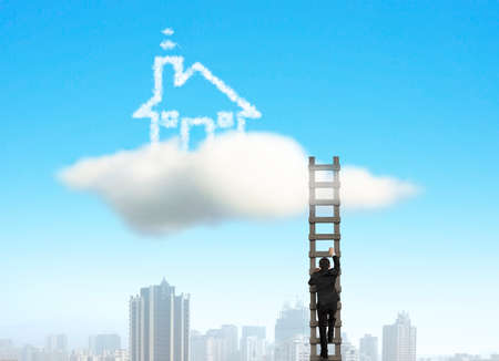 Businessman climbing on wooden ladder to cloud house with city view photo