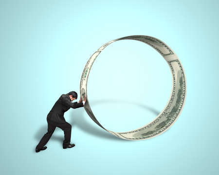 Businessman pushing money circle isolated in green Stock Photo