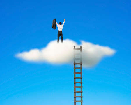 Cheered businessman on top of cloud with wooden ladder in clear blue sky background photo