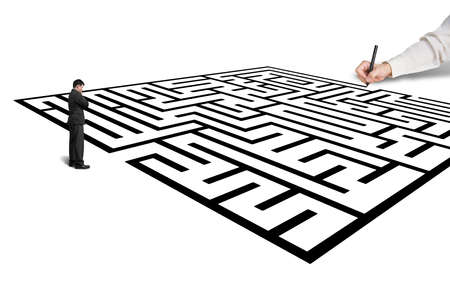 Hand drawing maze with thoughful businessman standing in from, white background photo