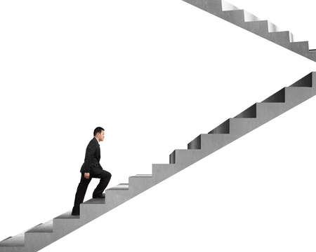 Businessman climbing on concrete stairs isolated in white  photo