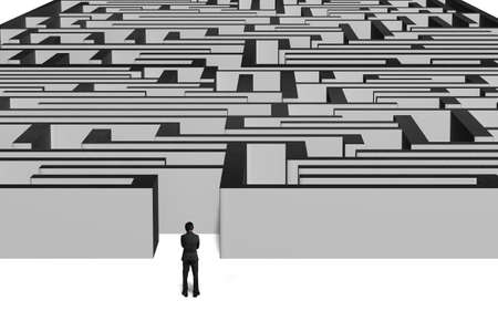 Businessman standing in front of maze with white ground photo