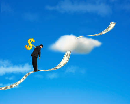 winder: Winder on businessmans back standing on growing money trend with cloud and blue sky