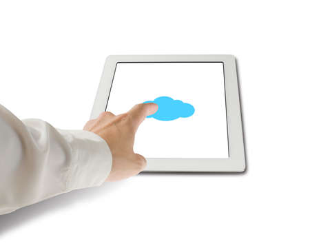 Hand touching cloud shape icon on tablet in white photo