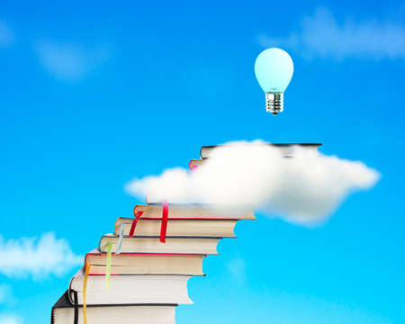 Stack of books through cloud with growing bulb and blue sky