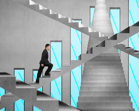 Businessman climbing on concrete stair with chart on concrete wall background photo