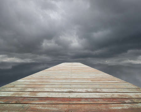 clouded: Wooden way with cloudy sky and spot in front, nobody