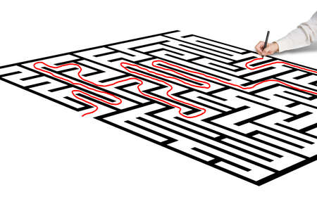 Hand drawing solution on maze in green background photo