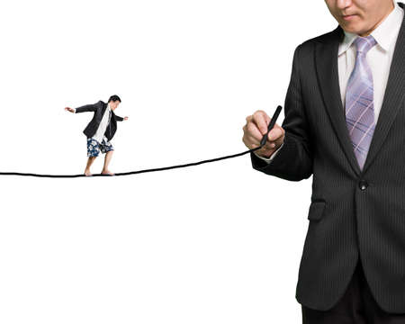 Businessman drawing line with another balancing on it in white background photo