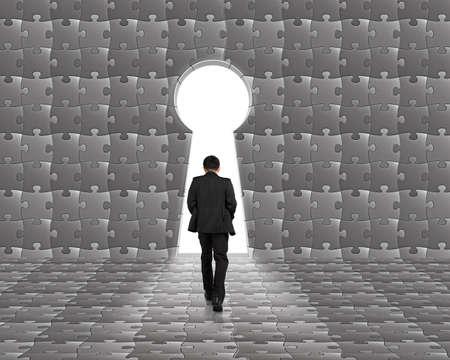 toward: Businessman walking toward key shape door with puzzles