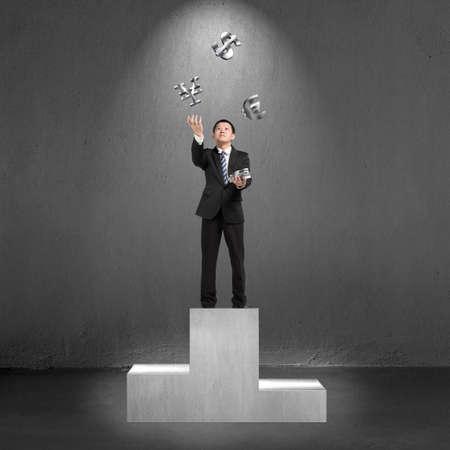 sliver: Businessman standing on podium throwing and catching 3D sliver money symbols