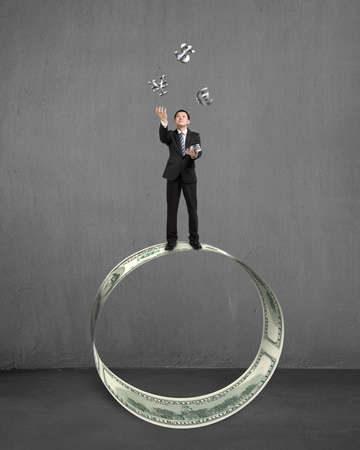 sliver: Businessman standing on money circle throwing and catching 3D sliver money symbols Stock Photo