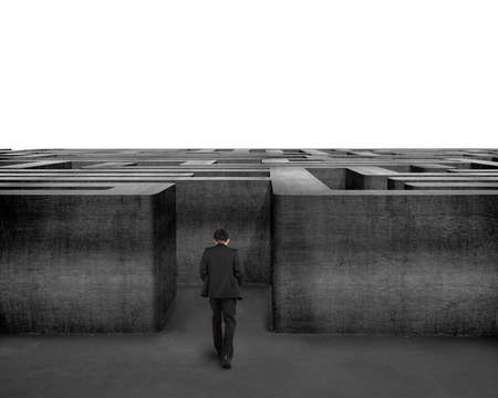 Rear view businessman walking toward to 3D concrete Maze in white background photo
