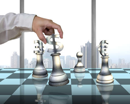 sports symbols metaphors: Hand holding money symbol others on table playing chess with city view