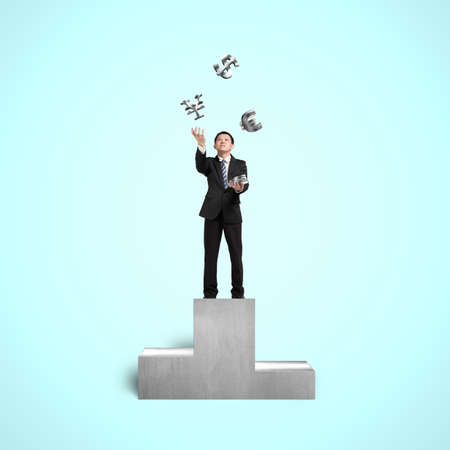 sliver: Businessman on podium throwing and catching 3D sliver money symbols in blue background Stock Photo