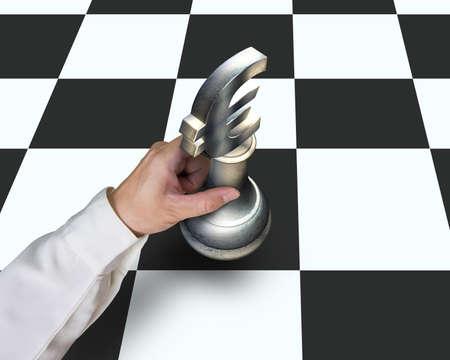 sports symbols metaphors: Hand locating sliver Euro symbol piece on chessboard