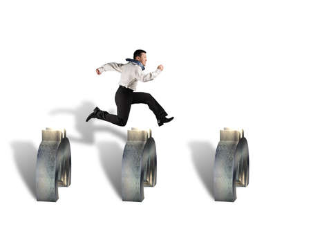 steeplechase: businessman jumping over euro symbols isolated in white  Stock Photo