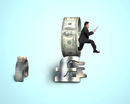 Businessman using tablet jumping through money circle photo