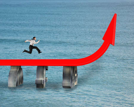 bridge over water: businessman running on red trend arrow bridge over water