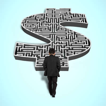 Businessman walking toward 3d money shape maze photo