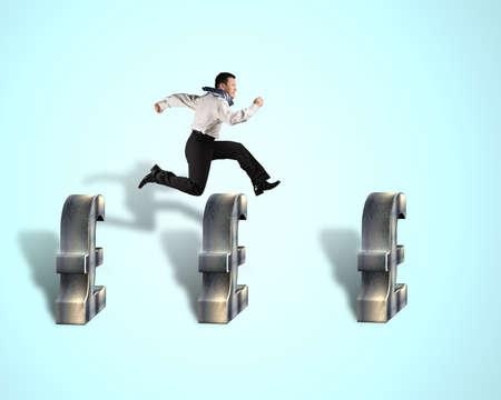 steeplechase: Businessman jumping over pound money symbol Stock Photo