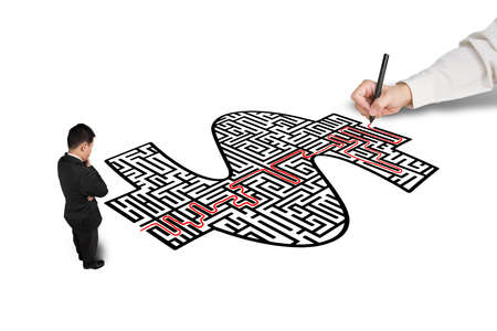 Hand drawing solution on money shape maze for a businessman isolated in white  photo