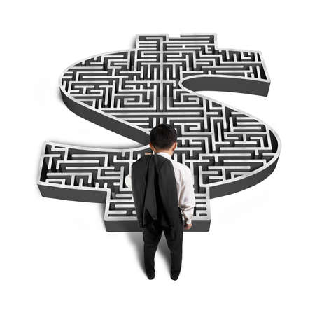 Businessman standing front of 3d money shape maze isolated in white  photo