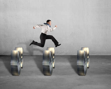 businessman jumping: Businessman jumping over USD symbols concrete  Stock Photo