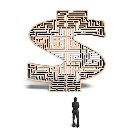 Businessman standing in front of 3d wooden money shape maze isolated in white  photo