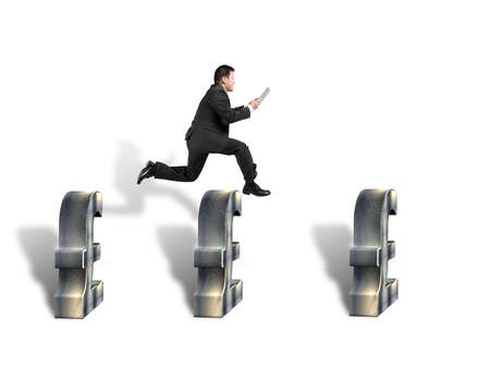 Businessman jumping over 3d pound symbols isolated in white  photo