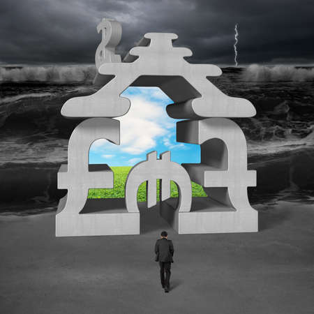 Businessman walking toward concrete money stacking building with tsunami and beautiful landsacpe photo
