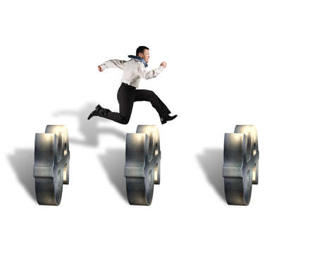 businessman jumping over money symbol obstacles isolated in white background