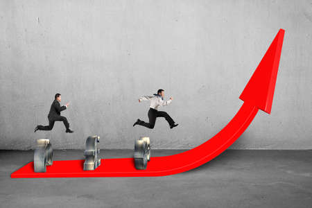 businessmen competing on growing red arrow concrete background