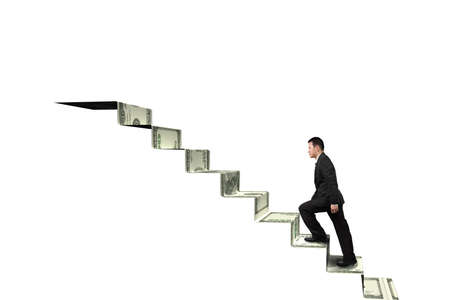 Climbing to top of money stairs isolated in white background photo