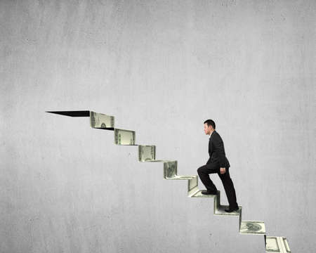 Walking on money stairs to top concrete wall background photo