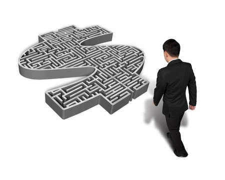 Man walking toward 3d money shape maze isolated on white  photo
