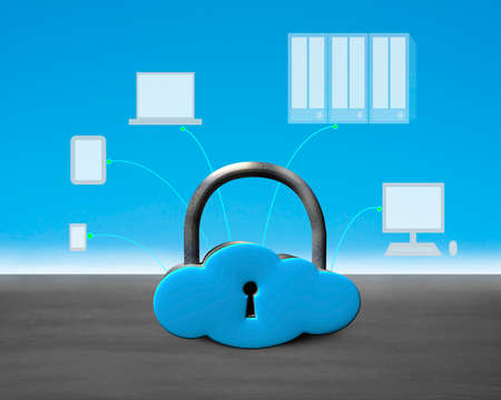 Cloud shape lock with computing devices on concrete ground photo