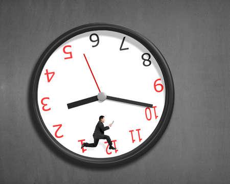 pneuma: Running inside clock on concrete wall