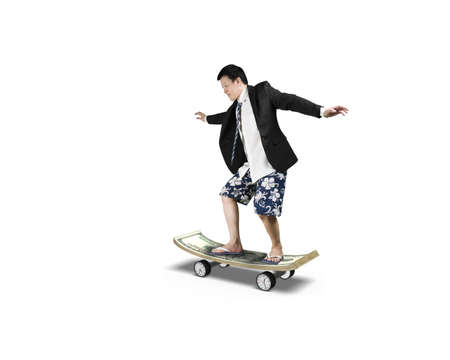 Skating on money skateboard with clock wheels isolated in white background photo
