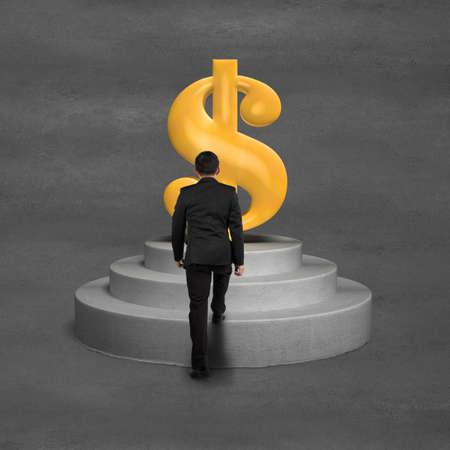 Businessman climbing on podium to gold money symbol concrete ground