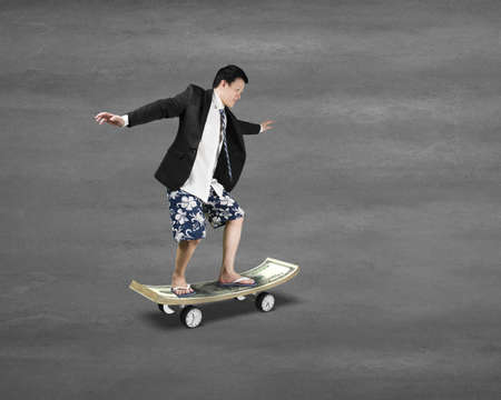 Skating on money skateboard with clock wheels on concrete ground photo