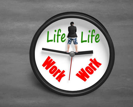 assignation: Rear view man standing on clock hands with life and work face concrete background Stock Photo
