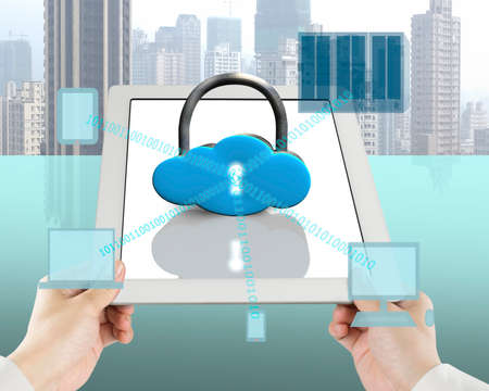 global security: Holding tablet with computing devices in office