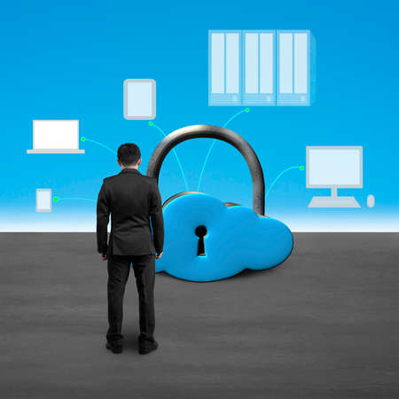 Man facing cloud shape lock with computing devices blue sky  background photo
