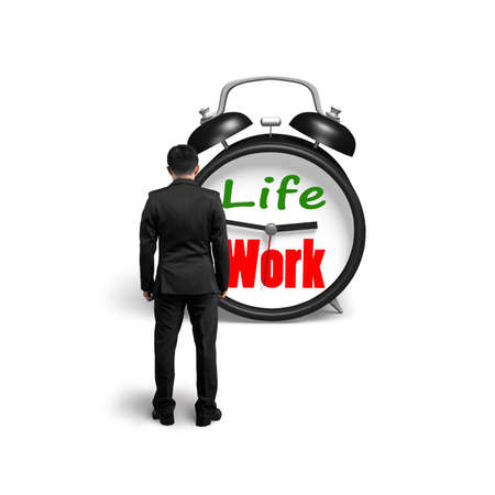 Man facing alarm clock with life and work face in white background photo