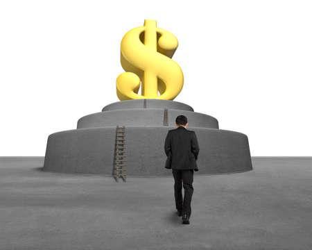 Businessman walking toward large money symbol in front photo