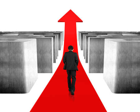 Walking on growing red arrow through maze isolated in white photo