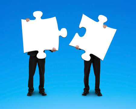 merge together: Two businessmen assembling puzzles blue background