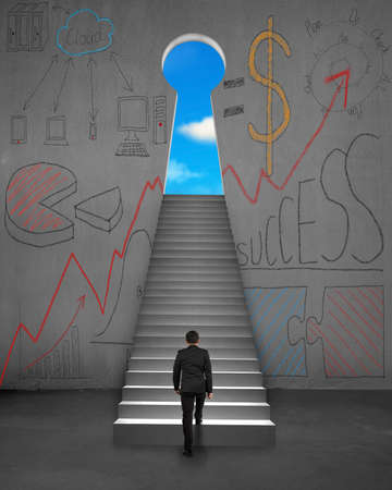 Climbing on stairs with business concept doodles on concrete wall photo
