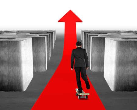 Skateboarding on red arrow through 3d concrete Maze photo